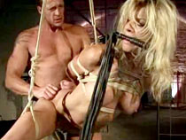 Blonde tortured in dungeon