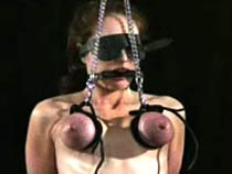 Blindfolded jugs bondage