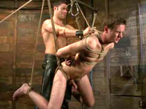 Gays tied down and flogged