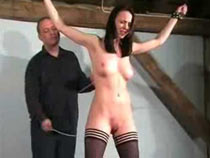 Girl tied up recieving pain
