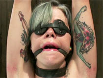Tattooed girl tortured