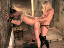 Beauteous Dominatrix strapon slave