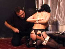 Hanging slave is subdued
