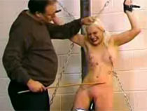 Blonde chained girl caned